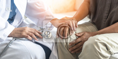 Obraz Parkinson's disease patient, Arthritis hand and knee pain or mental health care concept with geriatric doctor consulting examining elderly senior aged adult in medical exam clinic or hospital