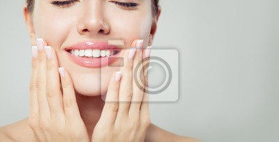Obraz Perfect woman smile and manicured hand. French manicure and pink lipgloss makeup