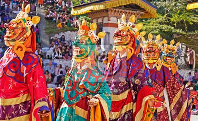 Obraz Performers dancers wearing masks in festival in Mongar, Bhutan