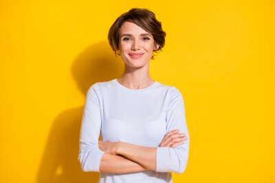Obraz Photo of confident young woman folded hands look camera wear white shirt isolated yellow color background