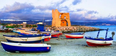 Picturesque old harbour with tradtional fishing boats and saracen tower in Briatico village. Calabria, Italy