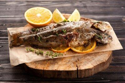 Obraz Pieczony pstrąg ryby z orange i tymiankiem