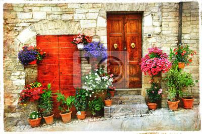 Piękne kwiatu uliczki starej włoskiej wsi. Spello, artisti