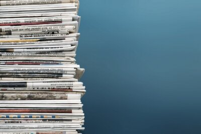 Obraz Pile of newspapers on background