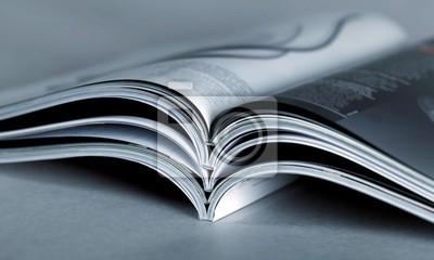 Obraz Pile of Open magazines, blue toned image