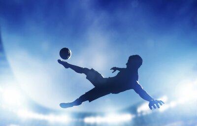 Obraz Piłka nożna mecz. Gracz strzela na bramkę