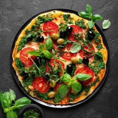 Obraz Pizza. Traditional italian pizza with green basil pesto sauce, top view