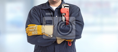 Obraz Plumber hand with wrench.