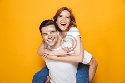 Obraz Portrait of a cheerful young couple standing