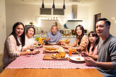 Obraz Portrait of Asian big family having dinner party in the kitchen.