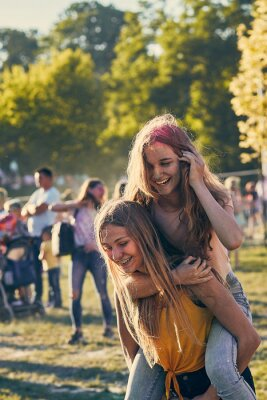 Obraz Portrait of happy young girls on holi color festival