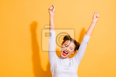 Obraz Portrait of her she nice-looking attractive lovely winsome sweet cheerful cheery optimistic girl having fun rejoicing raising hands up party isolated on bright vivid shine yellow background
