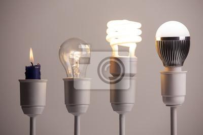 Obraz Postęp oświetlenie z świeca, żarówka, świetlówka i LED