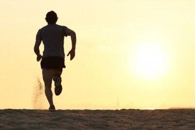 Obraz Powrót widzenia sylwetka biegacza człowiek działa na plaży