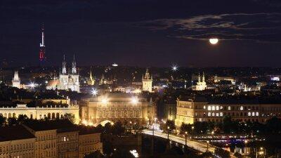 Prague cityscape at full moon night, Czech Republic.