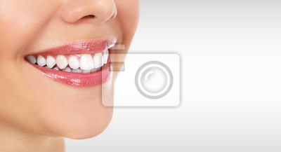 Obraz Pretty woman smile against a grey background with copyspace