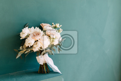 Obraz Printing and decor for a wedding with flowers. Modern Bridal bouquet in hand.