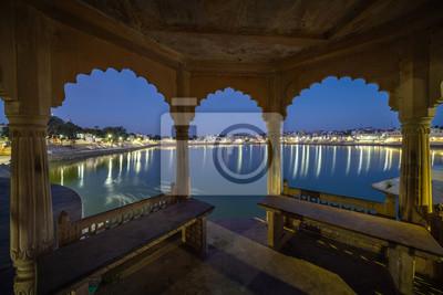 Pushkar lake after sunset, seen through Indian window frame. Pushkar, India