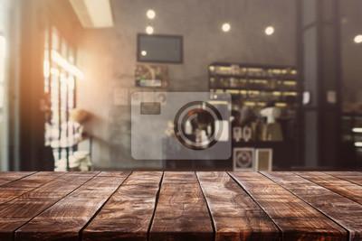 Obraz Pusty stary drewniany stołowy wierzchołek i zamazany bokeh kawiarni i sklep z kawą wewnętrzny tło z rocznikiem filtrujemy - może używać dla pokazu lub montażu twój produkty.