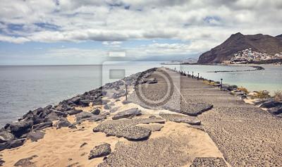 Quay at Playa de Las Teresitas beach, color toned picture, Tenerife, Spain.