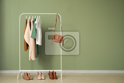 Obraz Rack with stylish clothes near color wall