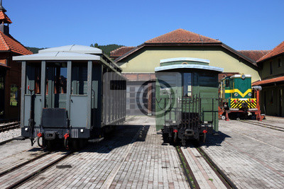 railway station with old locomotive and  wagons