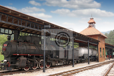 railway station with old steam locomotive