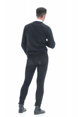 Obraz rear view. young man standing in front of a white screen