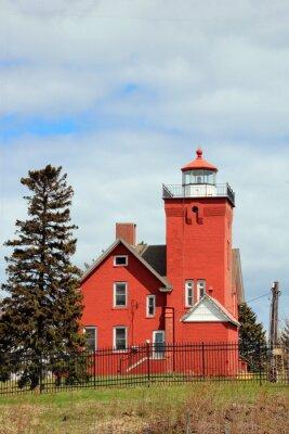 Obraz red lighthouse on the coast