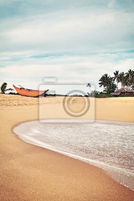 Retro color toned picture of an empty tropical beach, Sri Lanka.
