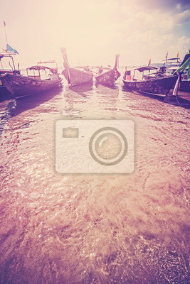 Retro filtered picture of boats on tropical beach, copy space.
