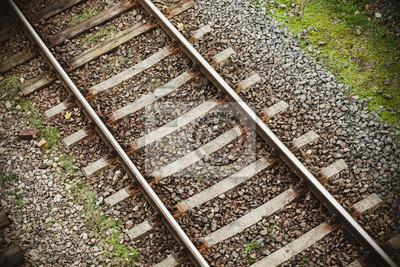 Retro filtrowane zdjęcie torów kolejowych tle.