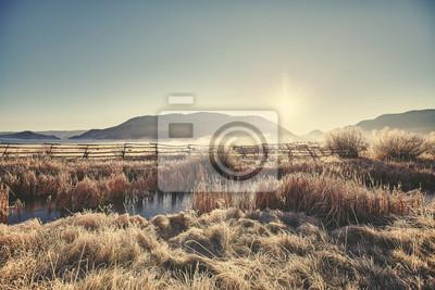 Retro stonowanych frosty wschód s? O? Ca w Grand Teton National Park, Wyoming, USA.