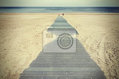 Retro stonowanych zdjęcie promenady na plaży.