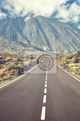 Retro stylized picture of a scenic road with Mount Teide in background, Teide National Park, Tenerife, Spain.