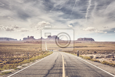 Retro stylized picture of Monument Valley seen from famous U.S. Route 163, Utah, USA.