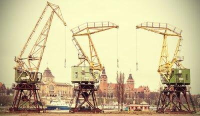 Retro stylizowany obraz żurawi Szczecina, Polska.