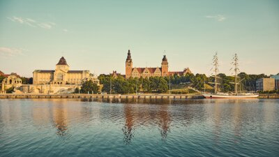 Retro toned panoramic picture of Waly Chrobrego (Hakenterrasse) with Provincial Office building and National Museum in Szczecin at sunrise, Poland.