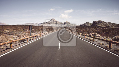 Retro toned picture of a scenic road in Teide National Park, Tenerife, Spain.