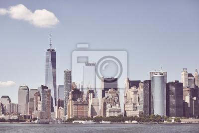 Retro toned picture of Manhattan skyline, New York City, USA.