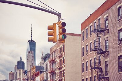 Retro toned picture of New York City traffic lights, selective focus, USA.