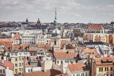 Retro toned picture of Prague cityscape, Czech Republic.