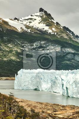 Retro toned picture of the Perito Moreno Glacier landscape, Argentina.