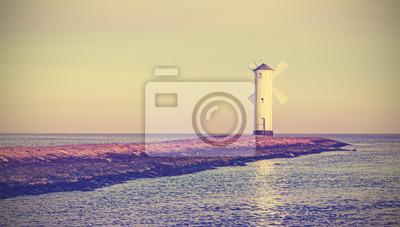 Retro vintage stylized sunrise over sea.