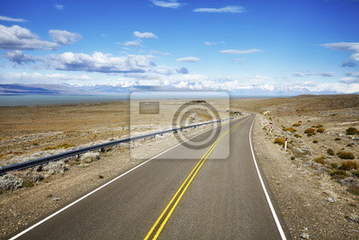 Road to El Chalten village with Fitz Roy Mountain range in background, Argentina.