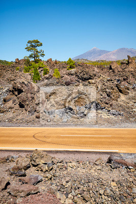 Road with Teide volcano in distance, Teide National Park, Tenerife, Spain.