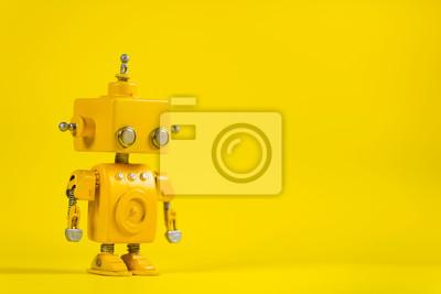 Obraz Robot na żółtym tle.