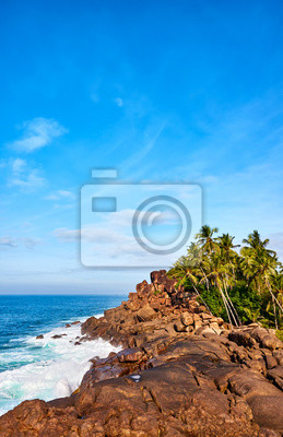 Rocky shore of the Indian Ocean on a sunny day.