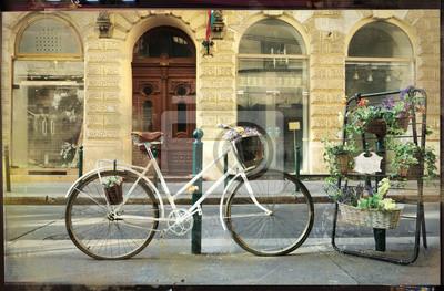 rocznik cards- stary rower z kwiatami na ulicy
