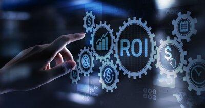 Obraz ROI Return on investment reading revenue business concept on virtual screen
